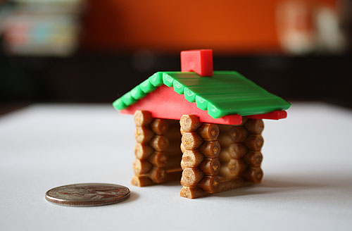 teeny tiny Lincoln Log cabin