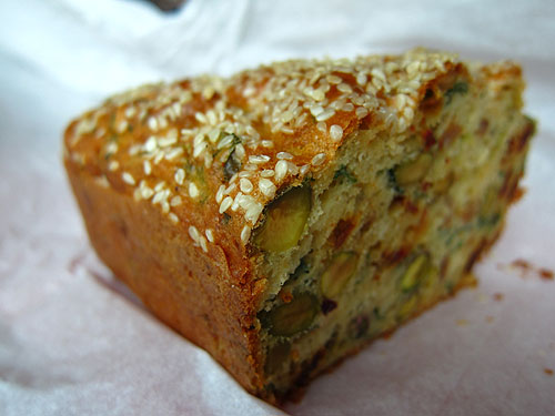 pistachio chorizo cake with sesame seeds on top