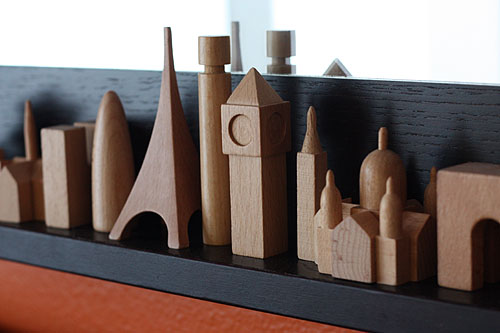 wooden figures of buildings from Paris and London