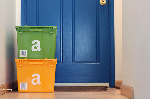yellow and green Amazon Fresh bins