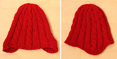 chunky red hat with short row earflaps, set flat on the floor to show details