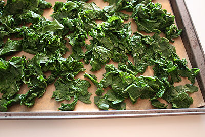 kale spread in single layer on a cookie sheet