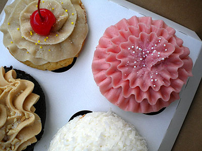 four cupcakes in a box