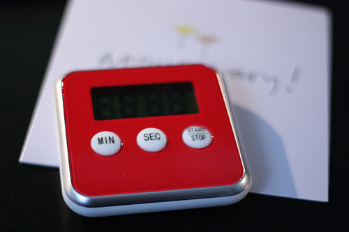 a cheery red kitchen timer
