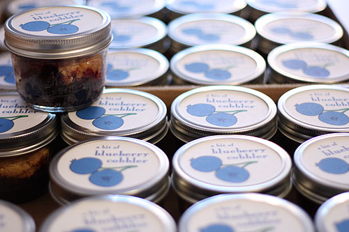 blueberry cobbler in jars, waiting to be taken to the bake sale