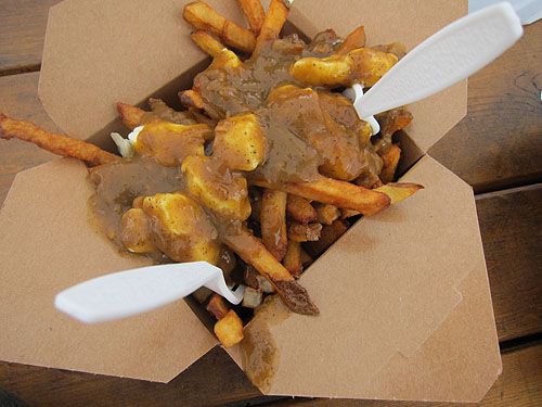 really good poutine, fries with gravy and cheese curds on top
