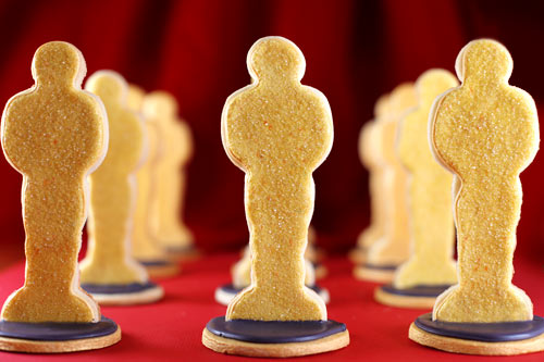 cookies arranged to look like Oscars statues, standing up in a slotted base
