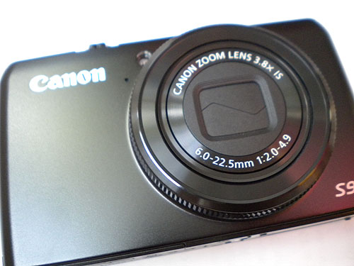 the Canon S90 camera, in a blurry overexposed shot taken by my old point and shoot