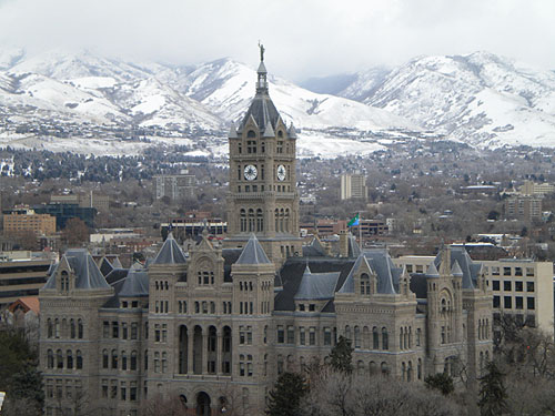 a view of a grand building and the mountains beyond