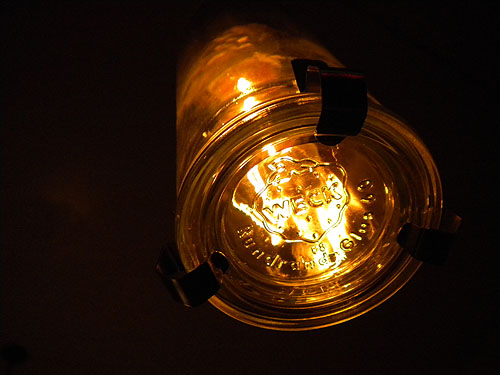 close up of a light fixture made using food jars