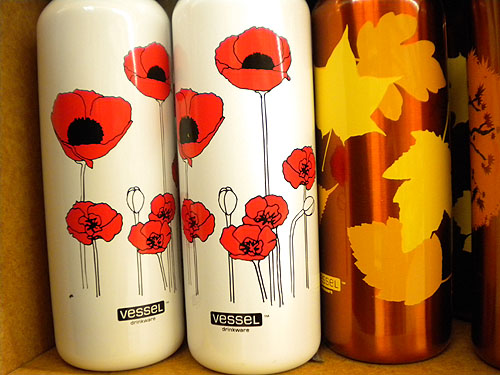a reusable water bottle with illustrated poppies on it