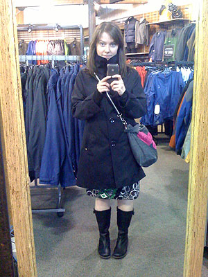 me in a mirror wearing a trech coat and boots, mostly all in black