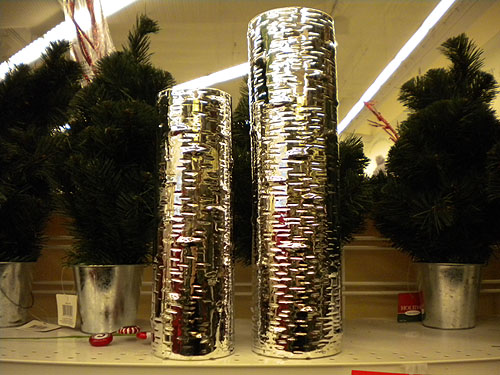 two vases shaped like birch trunks, but shiny chrome