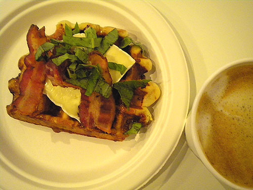 waffle piled with brie, bacon and basil