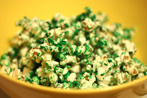 [kettle corn with green colored sugar coating]