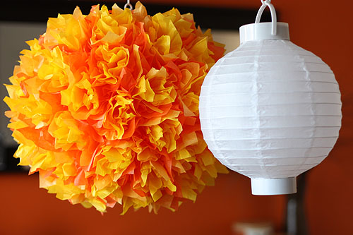 [paper lantern decorated with layers of orange tissue]