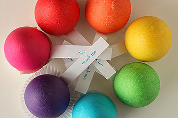 brightly colored eggshells with notes that say Crack Me