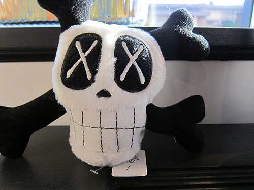 a skull and cross bones chew toy