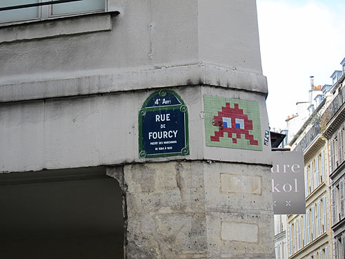 a Space Invader mural on a corner in Paris