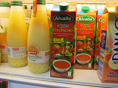a container of gazpacho in with the orange juice