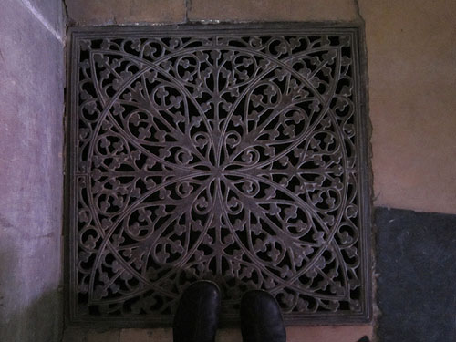 my feet at a decorative grate