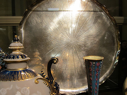 a large silver serving platter imprinted with the veins of a large leaf, it was striking
