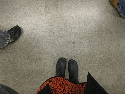 my feet waiting for my very first ride on the Metro