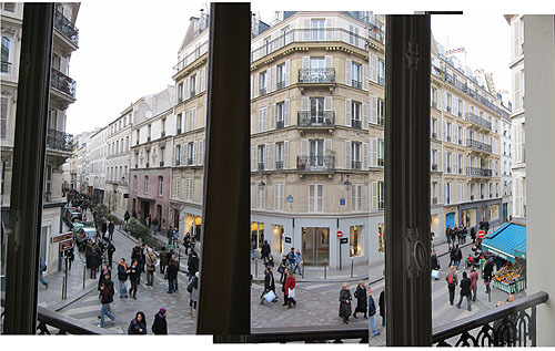 the view from our apartment window, two narrow Parisian streets, lots of pedestrians