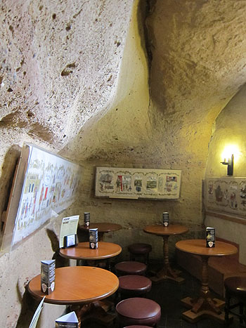 a pub room carved out of the rock in the hillside