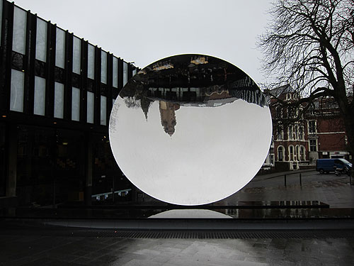 the Sky Mirror, reflecting a nearby building and sky, upside down, like in a spoon