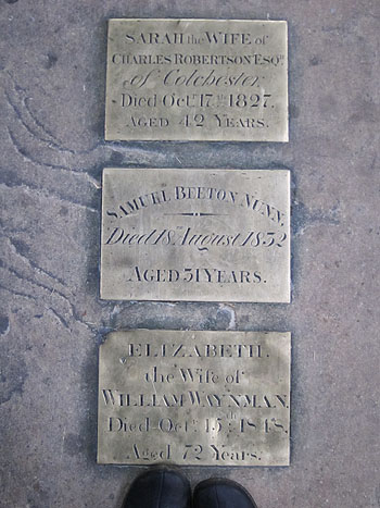 memorial stones set in the floor
