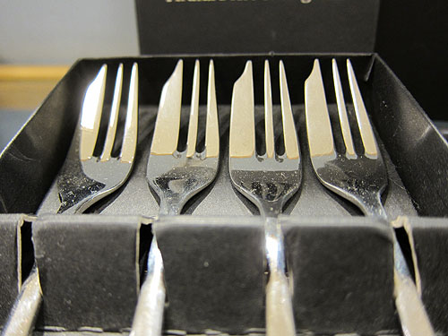 cake forks, with a wider side for cutting