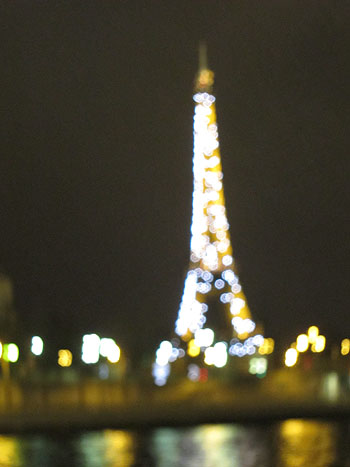out of focus Eiffel Tower, while it was flashing