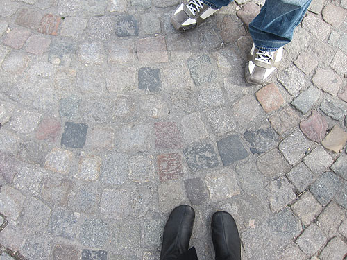 my boots and cobblestones, looking down