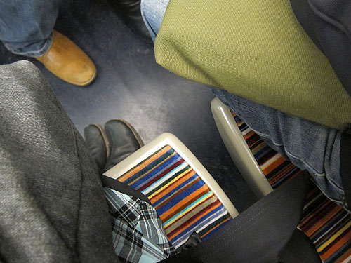 striped upholstry on the seat of the train