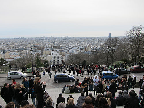 people hanging out on the steps of Sacre-Coeur