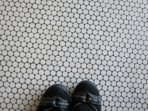 my feet on the tiled floor of Charles de Gaulle