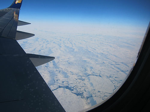 broken ice floating on waters, as seen from the plane