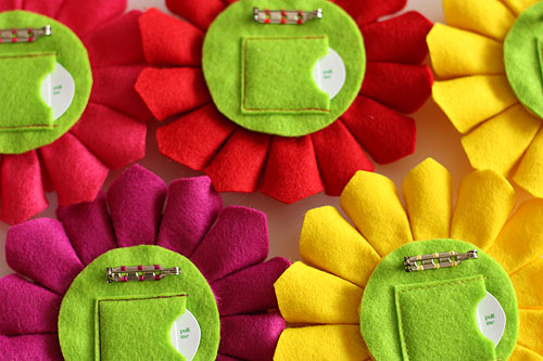 [pin backs showing pockets stitched in matched thread colors]