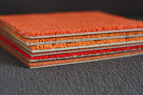 FLOR tiles in six different oranges