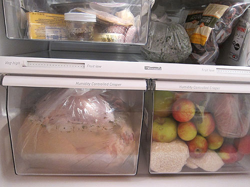 turkey in brine bag in the lower drawer of the fridge