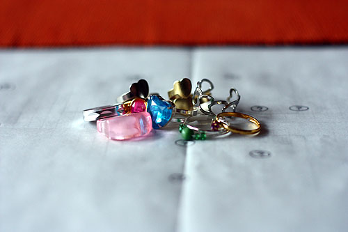 nine toy capsules containing rings