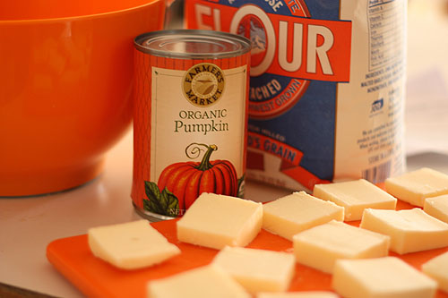 butter softening next to my orange mixing bowl, with an orange pumpkin can label and orange logo of my favorite flour