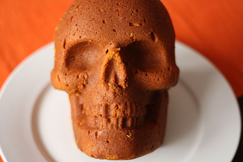another view of the a skull made of cake staring straight at the camera