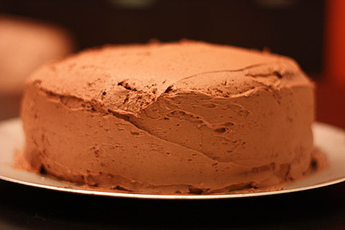 chocolate mousse frosting on yellow cake