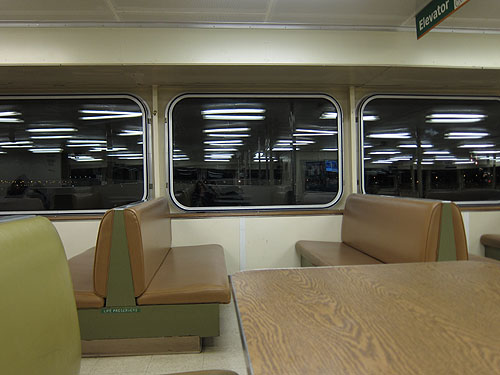 brightly lit and completely empty ferry