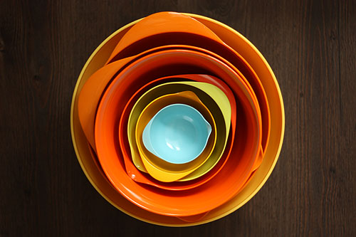 nested mixing bowls, yellow, oranges and blue
