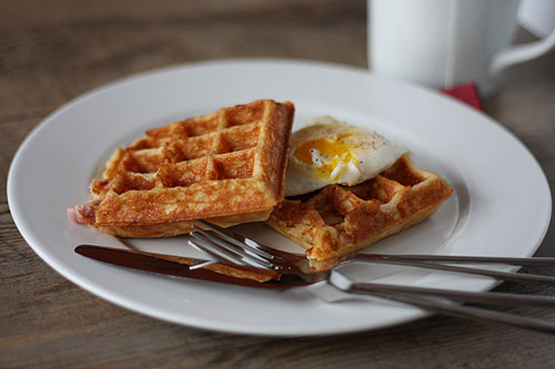 waffles with an over easy egg